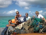 "Team Tern gets its goose on after filling another boat full of marine debris cut from the coral in Whale-Skate reef. (""Get your goose on"" was a Service wide public relations campaign that we participated in. The blue goose is the symbol of the National Wildlife Refuge System.)"