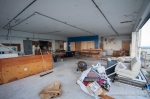 The inside of the common room after extensive clean-up and close-off efforts. The crew worked their tails off to clean up the mess and did great work boarding up this part of the building.